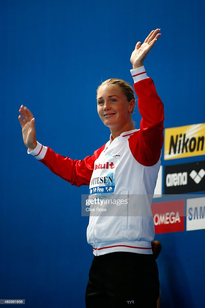 Silver medallist Jeanette Ottesen of Denmark looks on during the medal ceremony for the Women's 50m Butterfly Final on day fifteen of the 16th FINA World Championships at the Kazan Arena on August 8, 2015 in Kazan, Russia.