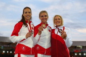 Silver medallist Jessica Zelinka of Canada gold medallist Brianne TheisenEaton of Canada and bronze medallist Jessica Taylor of England pose on the...