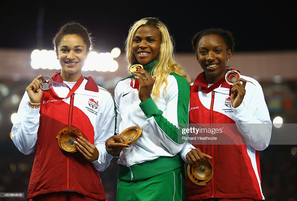 Silver medallist <a gi-track='captionPersonalityLinkClicked' href=/galleries/search?phrase=Jodie+Williams+-+Sprinter&family=editorial&specificpeople=5964402 ng-click='$event.stopPropagation()'>Jodie Williams</a> of England, gold medallist <a gi-track='captionPersonalityLinkClicked' href=/galleries/search?phrase=Blessing+Okagbare&family=editorial&specificpeople=5496695 ng-click='$event.stopPropagation()'>Blessing Okagbare</a> of Nigeria and bronze medallist <a gi-track='captionPersonalityLinkClicked' href=/galleries/search?phrase=Bianca+Williams&family=editorial&specificpeople=5970051 ng-click='$event.stopPropagation()'>Bianca Williams</a> of England pose on the podium during the medal ceremony for the Women's 200 metres at Hampden Park during day eight of the Glasgow 2014 Commonwealth Games on July 31, 2014 in Glasgow, United Kingdom.