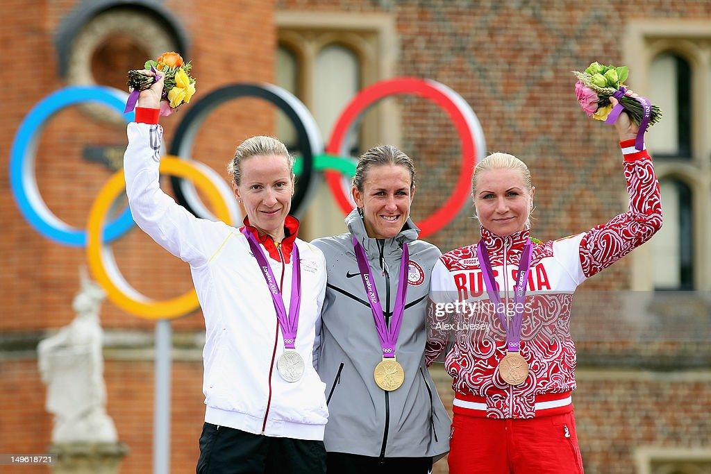 Silver medallist Judith Arndt of Germany gold medallist Kristin Armstrong of the United States and bronze medallist Olga Zabelinskaya of Russia...