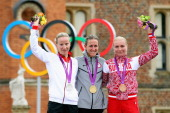 Silver medallist Judith Arndt of Germany gold medallist Kristin Armstrong of the United States and bronze medallist Olga Zabelinskaya of Russia...