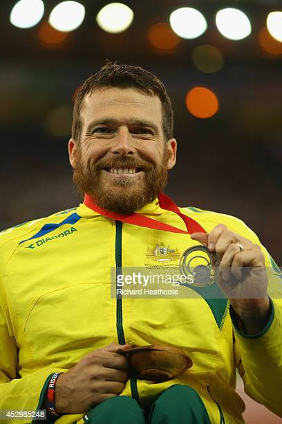 Silver medallist Kurt Fearnley of Australia on the podium during the medal ceremony for the Men's Para Sport 1500 metres T54 at Hampden Park during...