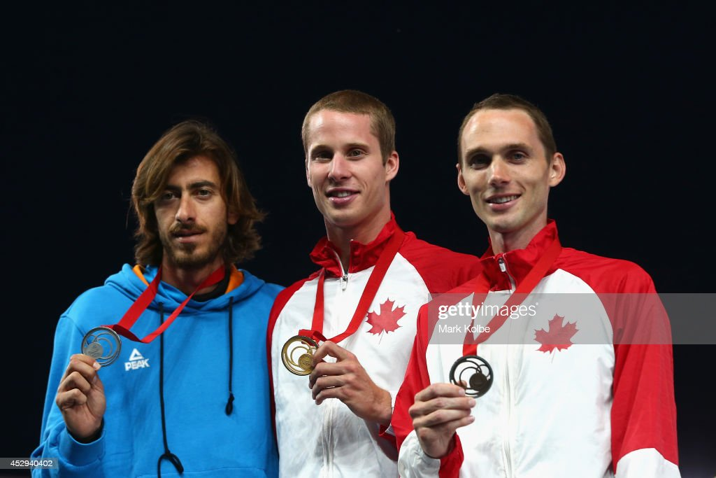 Silver medallist <a gi-track='captionPersonalityLinkClicked' href=/galleries/search?phrase=Kyriakos+Ioannou&family=editorial&specificpeople=2286653 ng-click='$event.stopPropagation()'>Kyriakos Ioannou</a> of Cyprus, gold medallist <a gi-track='captionPersonalityLinkClicked' href=/galleries/search?phrase=Derek+Drouin&family=editorial&specificpeople=9541960 ng-click='$event.stopPropagation()'>Derek Drouin</a> of Canada and bronze medallist <a gi-track='captionPersonalityLinkClicked' href=/galleries/search?phrase=Michael+Mason+-+High+Jumper&family=editorial&specificpeople=9623752 ng-click='$event.stopPropagation()'>Michael Mason</a> of Canada pose on the podium during the medal ceremony for the Men's High Jump at Hampden Park during day seven of the Glasgow 2014 Commonwealth Games on July 30, 2014 in Glasgow, United Kingdom.