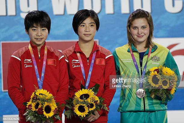 Silver medallist Liu Huixia gold medallist Huang Xiaohui of China and Bronze medallist Melissa Wu of Australia celebrate during the medal ceremony...