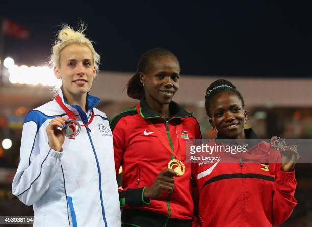 Silver medallist Lynsey Sharp of Scotland gold medallist Eunice Jepkoech Sum of Kenya and bronze medallist Winnie Nanyondo of Uganda pose on the...