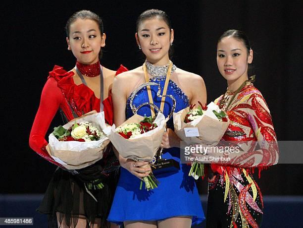 Silver medallist Mao Asada of Japan gold medallist Kim YuNa of South Korea and bronze medallist Yukari Nakano of Japan pose on the podium at the...