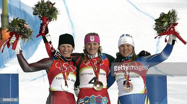 silver medallist Marlies Schild of Austria gold medallist Janica Kostelic of Croatia and bronze medallist Anja Paerson of Sweden after receiving...