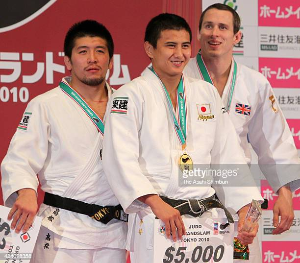 Silver medallist Masahiro Takamatsu gold medallist Takahiro Nakai and bronze medallist Leandro Guilheiro pose on the podium at the medal ceremony for...