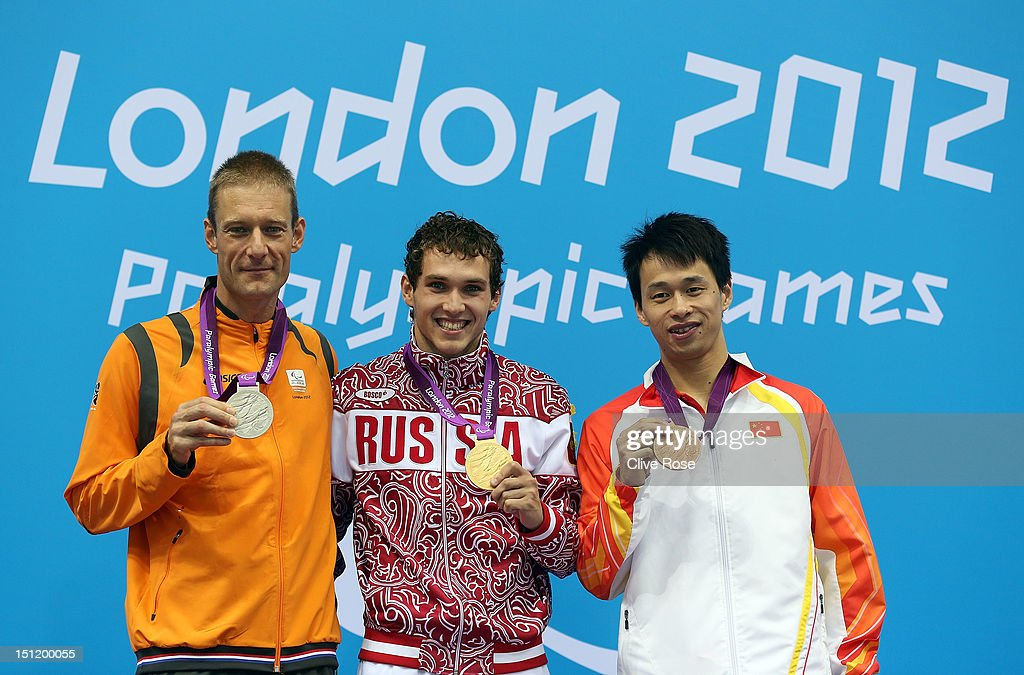Silver medallist Maurice Deelen of Netherlands, gold medallist Denis Tarasov of Russia and bronze medallist Yinan Wang of China pose on the podium during the medal ceremony for the Men's 50m Freestyle - S8 final on day 5 of the London 2012 Paralympic Games at Aquatics Centre on September 3, 2012 in London, England.