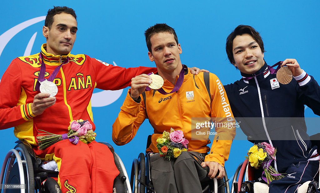 Silver medallist Miguel Luque of Spain, gold medallist Michael Schoenmaker of Netherlands and bronze medallist Takayuki Suzuki of Japan pose on the podium during the medal ceremony for the Men's 50m Breaststroke - SB3 final on day 5 of the London 2012 Paralympic Games at Aquatics Centre on September 3, 2012 in London, England.