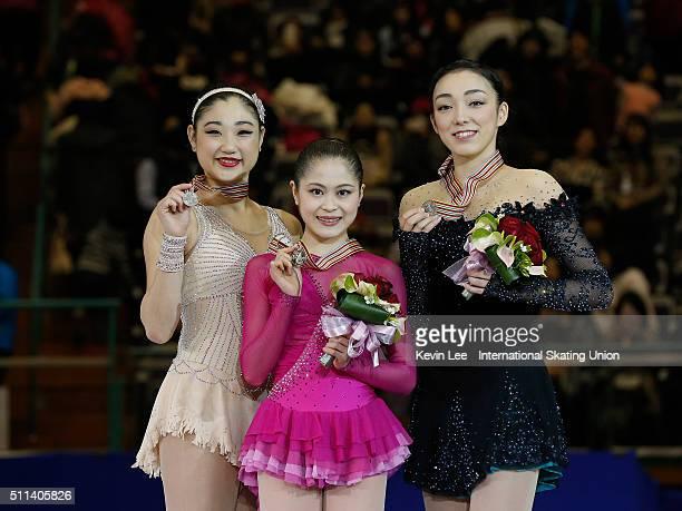 Silver Medallist Mirai Nagasu of United States Gold Medalist Satoko Miyahara of Japan and Rika Hongo of Japan stand on podium after the Ladies Free...
