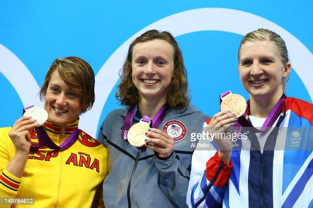 Silver medallist Mireia Belmonte Garcia of Spain gold medallist Katie Ledecky of the United States and bronze medallist Rebecca Adlington of Great...