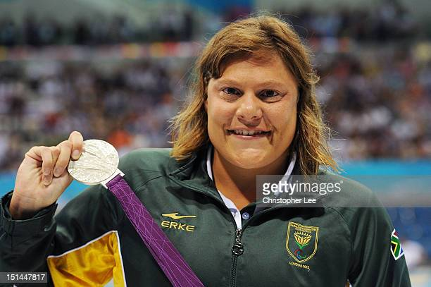 Silver medallist Natalie du Toit of South Africa poses on the podium during the medal ceremony for the Women's 100m Freestyle S9 final on day 9 of...