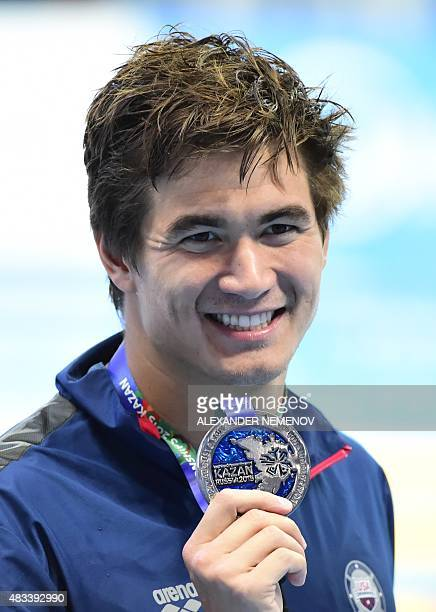 US silver medallist Nathan Adrian poses on the podium of the men's 50m freestyle swimming event at the 2015 FINA World Championships in Kazan on...