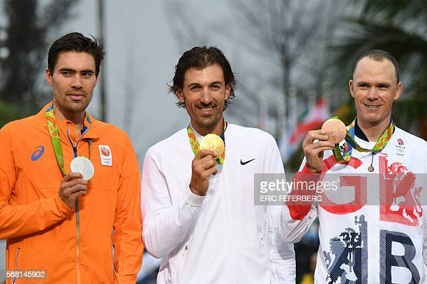 Silver medallist Netherlands' Tom Dumoulin gold medallist Switzerland's Fabian Cancellara and bronze medallist Britain's Christopher Froome pose on...