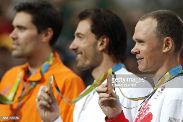 TOPSHOT Silver medallist Netherlands' Tom Dumoulin gold medallist Switzerland's Fabian Cancellara and bronze medallist Britain's Christopher Froome...