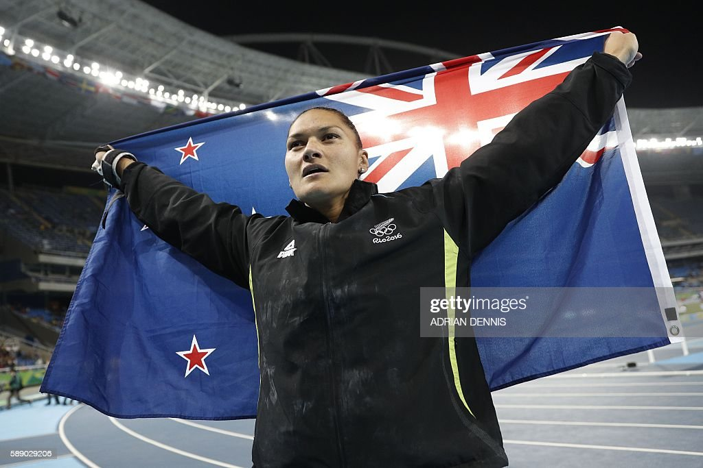 Silver medallist New Zealand's Valerie Adams celebrates after the Women's Shot Put Final during the athletics event at the Rio 2016 Olympic Games at the Olympic Stadium in Rio de Janeiro on August 12, 2016. / AFP / Adrian DENNIS