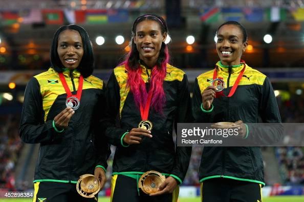 Silver medallist Novlene WilliamsMills of Jamaica Gold medallist Stephanie McPherson of Jamaica and bronze medallist Christine Day of Jamaica pose on...