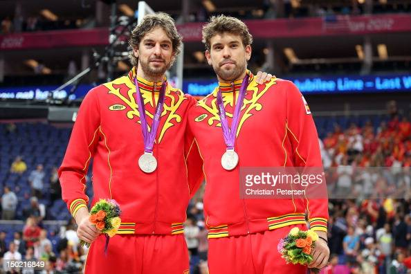 Silver medallist Pau Gasol of Spain and Marc Gasol of Spain pose on the podium during the medal ceremony for the Men's Basketball on Day 16 of the...