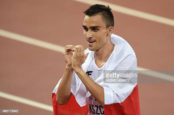 Silver medallist Poland's Adam Kszczot celebrates after the final of the men's 800 metres athletics event at the 2015 IAAF World Championships at the...