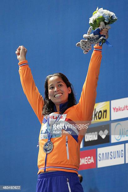 Silver medallist Ranomi Kromowidjojo of the Netherlands celebrates during the medal ceremony for the Women's 50m Freestyle Final during day sixteen...