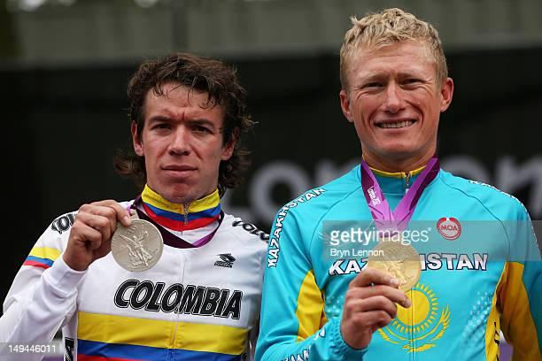 Silver medallist Rigoberto Uran Uran of Colombia and gold medallist Alexandr Vinokurov of Kazakhstan celebrate during the Victory Ceremony for the...