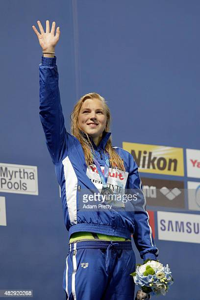 Silver medallist Ruta Meilutyte of Lithuania celebrates during the medal ceremony for the Women's 100m Breaststroke Final on day eleven of the 16th...
