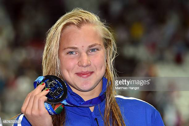 Silver medallist Ruta Meilutyte of Lithuania poses during the medal ceremony for the Women's 100m Breaststroke Final on day eleven of the 16th FINA...