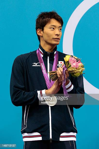 Silver medallist Ryosuke Irie of Japan poses on the podium during the medal ceremony for the Men's 200m Backstroke final on Day 6 of the London 2012...