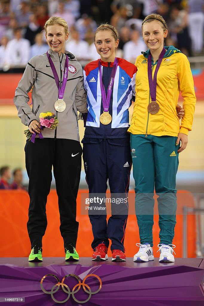 Silver medallist <a gi-track='captionPersonalityLinkClicked' href=/galleries/search?phrase=Sarah+Hammer&family=editorial&specificpeople=688673 ng-click='$event.stopPropagation()'>Sarah Hammer</a> of the United States, Gold medallist <a gi-track='captionPersonalityLinkClicked' href=/galleries/search?phrase=Laura+Trott+-+Cyclist&family=editorial&specificpeople=7205074 ng-click='$event.stopPropagation()'>Laura Trott</a> of Great Britain, and <a gi-track='captionPersonalityLinkClicked' href=/galleries/search?phrase=Annette+Edmondson&family=editorial&specificpeople=4872666 ng-click='$event.stopPropagation()'>Annette Edmondson</a> of Australia celebrates during the medal ceremony for the Women's Omnium Track Cycling on Day 11 of the London 2012 Olympic Games at Velodrome on August 7, 2012 in London, England.