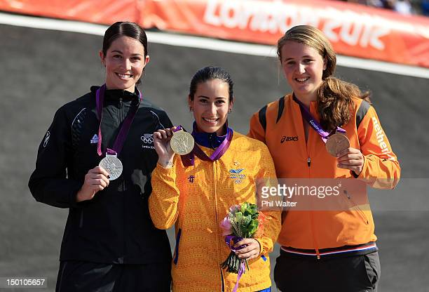 Silver medallist Sarah Walker of New Zealand Gold medallist Mariana Pajon of Colombia and Bronze medallist Laura Smulders of the Netherlands...