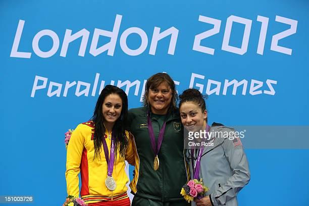 Silver medallist Sarai Gascon of Spain gold medallist Natalie du Toit of South Africa and bronze medallist Elizabeth Stone of the United States pose...
