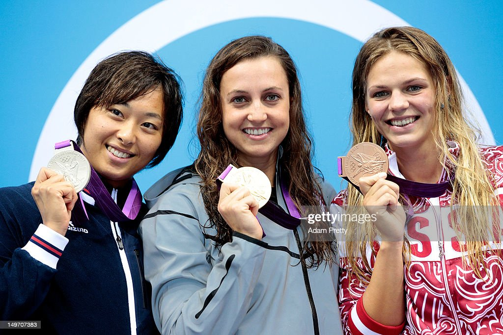 Silver medallist <a gi-track='captionPersonalityLinkClicked' href=/galleries/search?phrase=Satomi+Suzuki&family=editorial&specificpeople=9595153 ng-click='$event.stopPropagation()'>Satomi Suzuki</a> of Japan, gold medallist Rebecca Soni of the United States and bronze medallist Iuliia Efimova of Russia pose on the podium during the medal ceremony for the Women's 200m Breaststroke Final on Day 6 of the London 2012 Olympic Games at the Aquatics Centre on August 2, 2012 in London, England. Soni set a new world record time of 2:19.59 for the event.