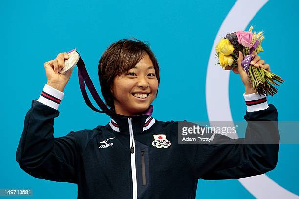 Silver medallist Satomi Suzuki of Japan poses on the podium during the medal ceremony for the Women's 200m Breaststroke Final on Day 6 of the London...