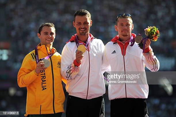 Silver medallist Scott Reardon of Australia gold medallist Heinrich Popow of Germany and bronze medallist Wojtek Czyz of Germany pose on the podium...