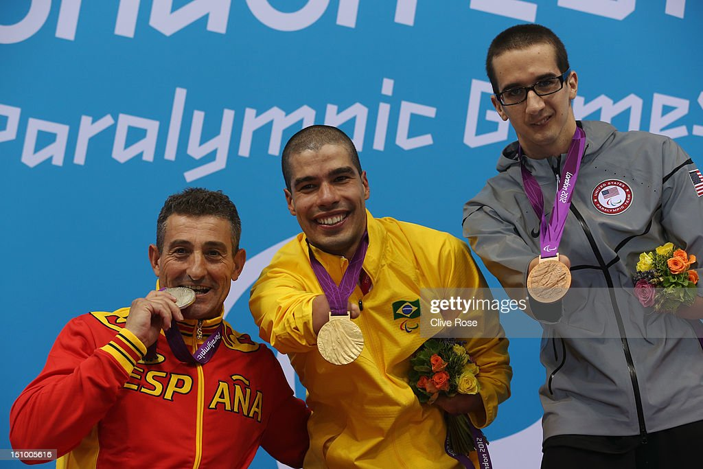 Silver medallist Sebastian Rodriguez of Spain, gold medallist Daniel Dias of Brazil and bronze medallist Roy Perkins of the United States pose on the podium during the medal ceremony for the Men's 50m Freestyle - S5 final on day 1 of the London 2012 Paralympic Games at Aquatics Centre on August 30, 2012 in London, England.