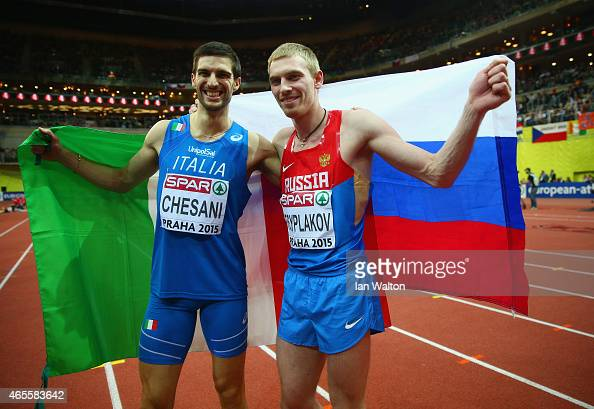 Silver medallist Silvano Chesani of Italy poses with gold medallist Daniyil Tsyplakov of Russia after the Men's High Jump Final during day three of...