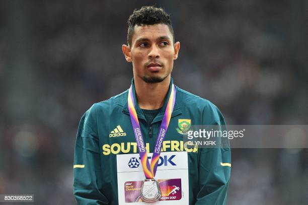 Silver medallist South Africa's Wayde Van Niekerk poses on the podium during the victory ceremony for the men's 200m athletics event at the 2017 IAAF...