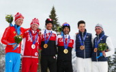 Silver medallist Stanislav Chokhlaev of Russia and guide Maksim Pirogov gold medalist Brian McKeever of Canada and guide Erik Carleton and bronze...