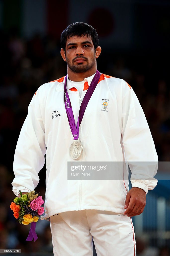 Silver medallist <a gi-track='captionPersonalityLinkClicked' href=/galleries/search?phrase=Sushil+Kumar&family=editorial&specificpeople=703954 ng-click='$event.stopPropagation()'>Sushil Kumar</a> of India celebrates with his medal during the medal ceremony following the Men's Freestyle 66 kg Wrestling gold medal fight on Day 16 of the London 2012 Olympic Games at ExCeL on August 12, 2012 in London, England.