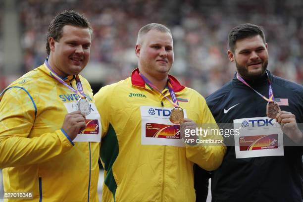 Silver medallist Sweden's Daniel Stahl gold medallist Lithuania's Andrius Gudius and bronze medallist US athlete Mason Finley pose on the podium...