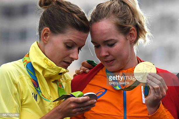 Silver medallist Sweden's Emma Johansson and Gold medallist Netherlands' Anna Van Der Breggen pose on the podium after the Women's road cycling race...