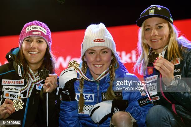 Silver medallist Switzerland's Wendy Holdener gold medallists US skier Mikaela Shiffrin and bronze medallist Sweden's Frida Hansdotter pose on the...