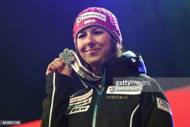 Silver medallist Switzerland's Wendy Holdener poses on the podium of the women's slalom race at the 2017 FIS Alpine World Ski Championships in St...