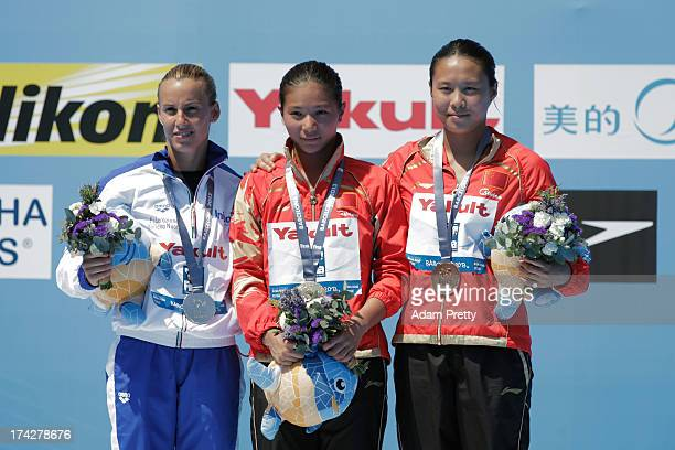 Silver medallist Tania Cagnotto of Italy gold medallist He Zi of China and bronze medallist Han Wang of China celebrate after the Women's 1m...
