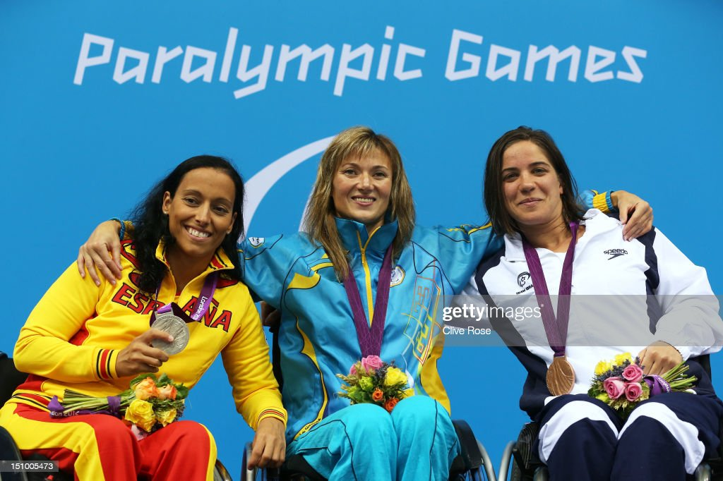 Silver medallist Teresa Perales of Spain, gold medallist Natalia Prologaieva of Ukraine and bronze medallist Inbal Pezaro of Israel pose on the podium during the medal ceremony for the Women's 50m Freestyle - S5 final on day 1 of the London 2012 Paralympic Games at Aquatics Centre on August 30, 2012 in London, England.