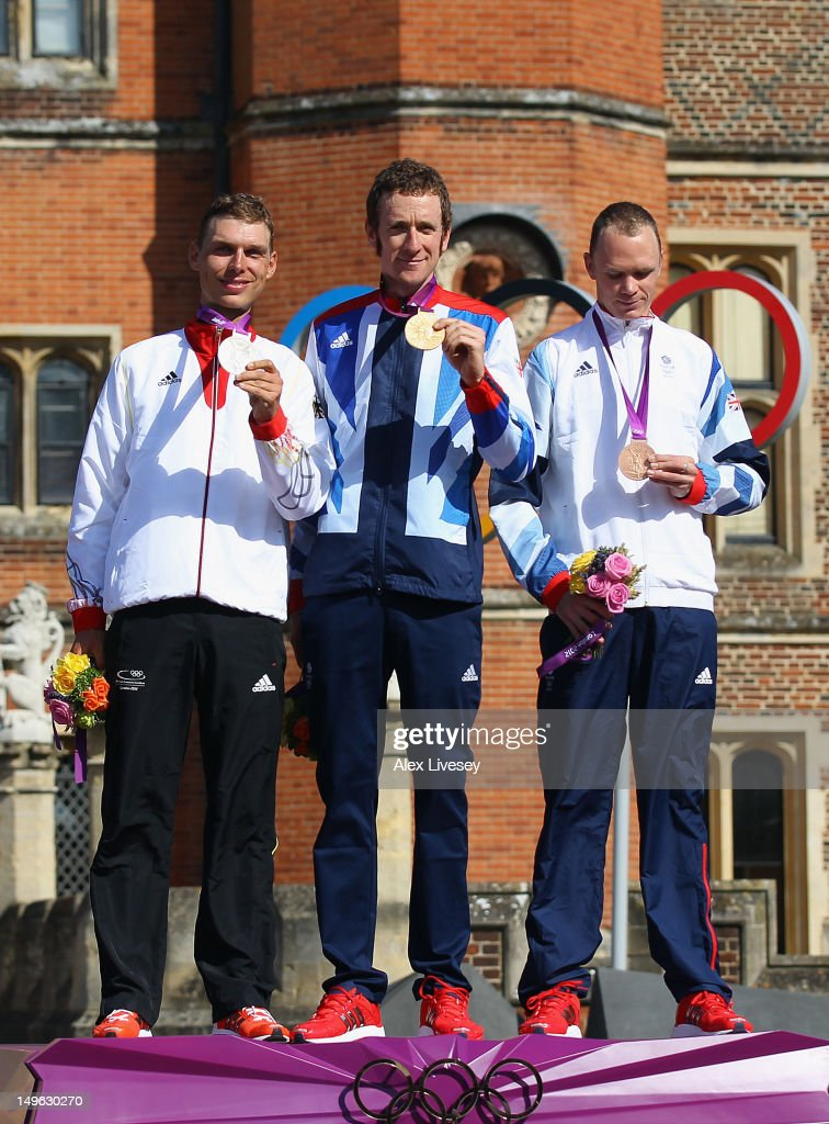 Silver medallist Tony Martin of Germany, gold medallist Bradley Wiggins of Great Britain and bronze medallist Christopher Froome of Great Britain celebrate during the victory ceremony after the Men's Individual Time Trial Road Cycling on day 5 of the London 2012 Olympic Games on August 1, 2012 in London, England.