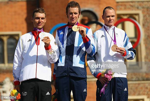 Silver medallist Tony Martin of Germany gold medallist Bradley Wiggins of Great Britain and bronze medallist Christopher Froome of Great Britain...