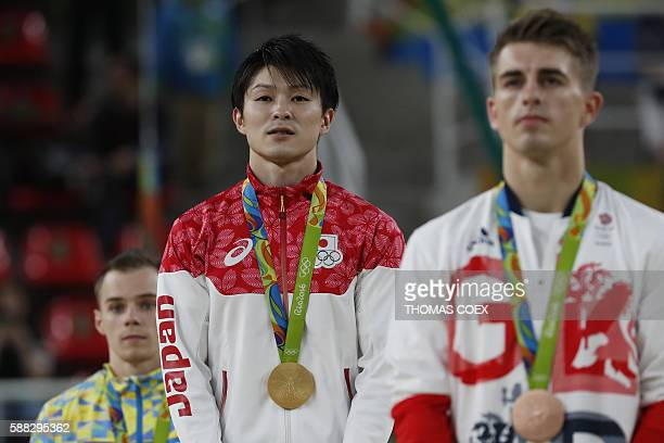 Silver medallist Ukraine's Oleg Verniaiev gold medallist Japan's Kohei Uchimura and bronze medallist Britain's Max Whitlock pose on the podium of the...