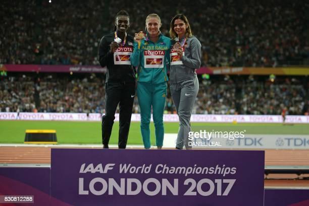 Silver medallist US athlete Dawn Harper Nelson gold medallist Australia's Sally Pearson and bronze medallist Germany's Pamela Dutkiewicz pose on the...